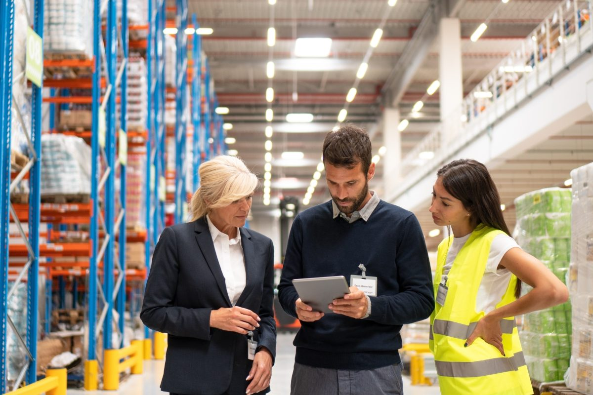 storage warehouse with executives discussing inventory
