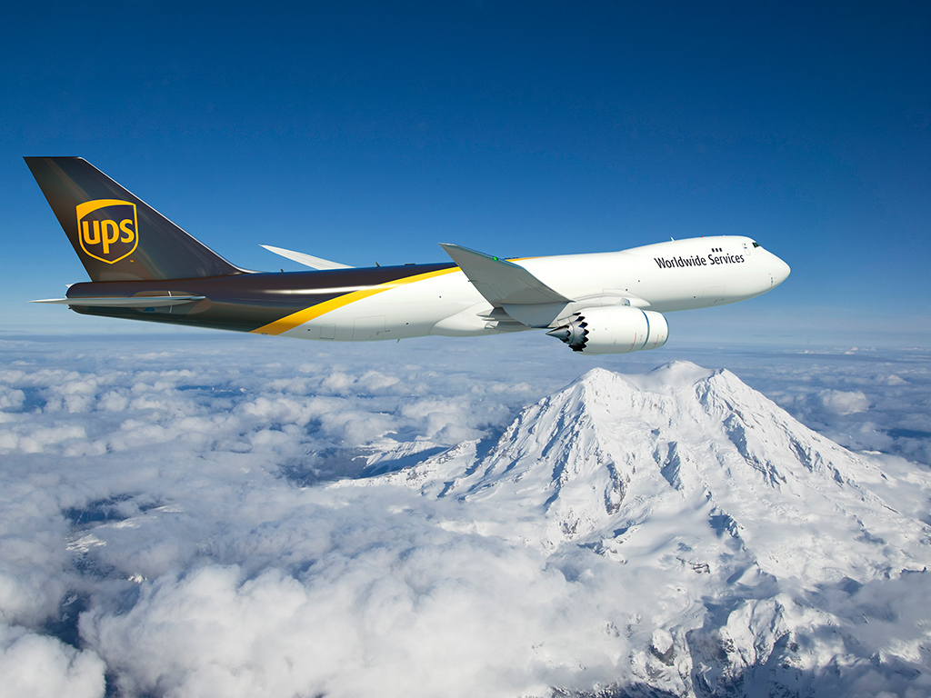 UPS plane flying over mountains